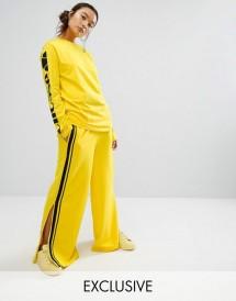 Ellesse - Pantalon large avec bande latérale contrastante en satin